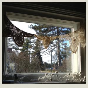 doilies in window 1