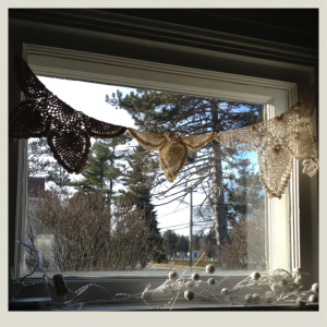 doilies in window 1
