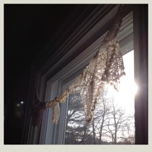 doilies in window 2