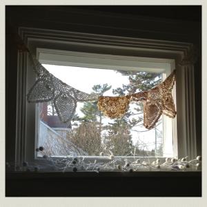 doilies in window 3