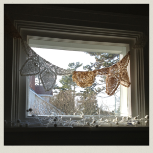 doilies in window 3