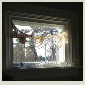 doilies in window 4
