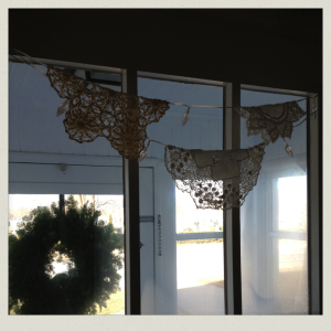 doilies in window 5