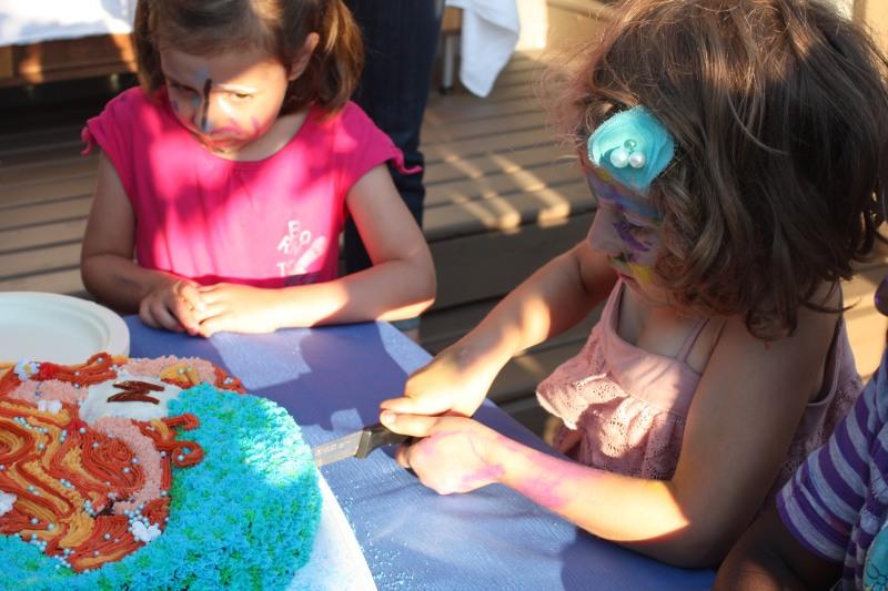 The Birthday Girl cutting her cake