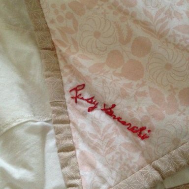 My maternal grandmother's signature as embroidered by her daughter, my mother.