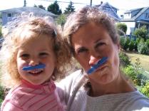 Mikaya and Mumma wearing a mustache