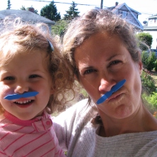 Mikaya and Mumma wearing a mustache